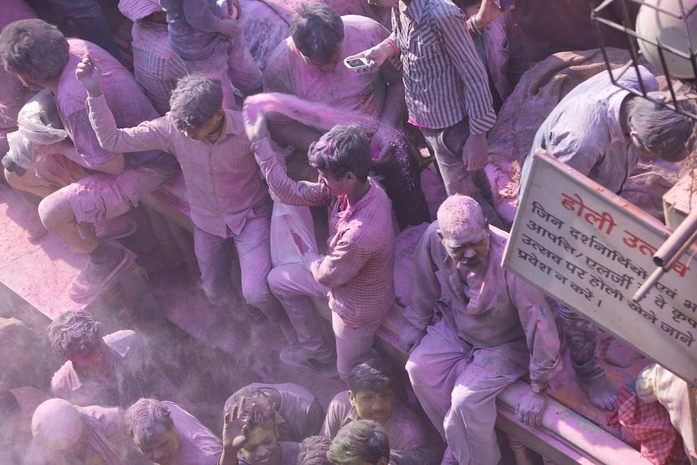 Festival goers with purple dye