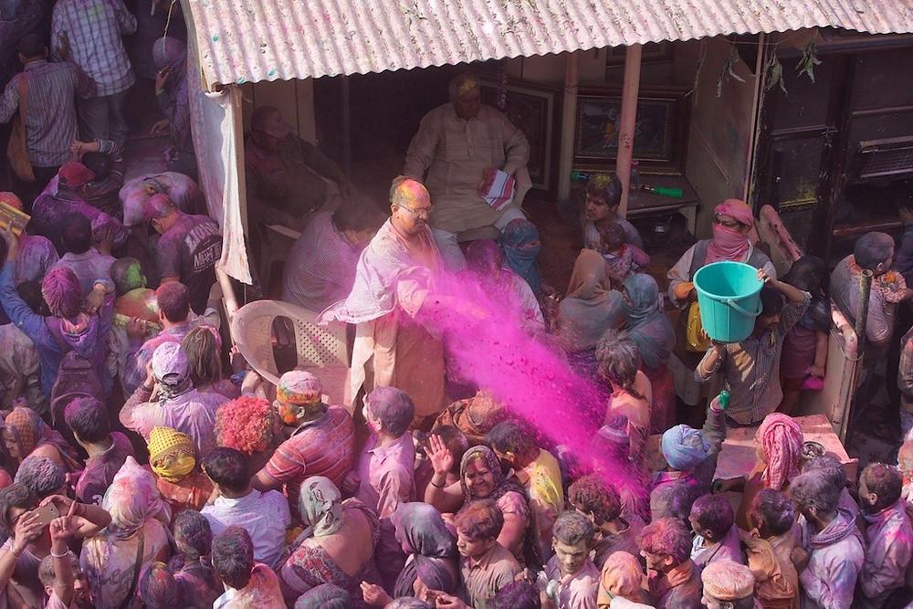 Man throwing dye into crowd