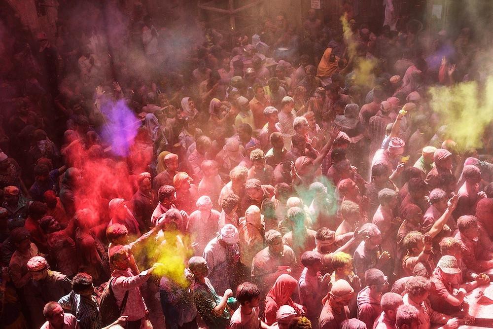 large crowd celebrating Holi