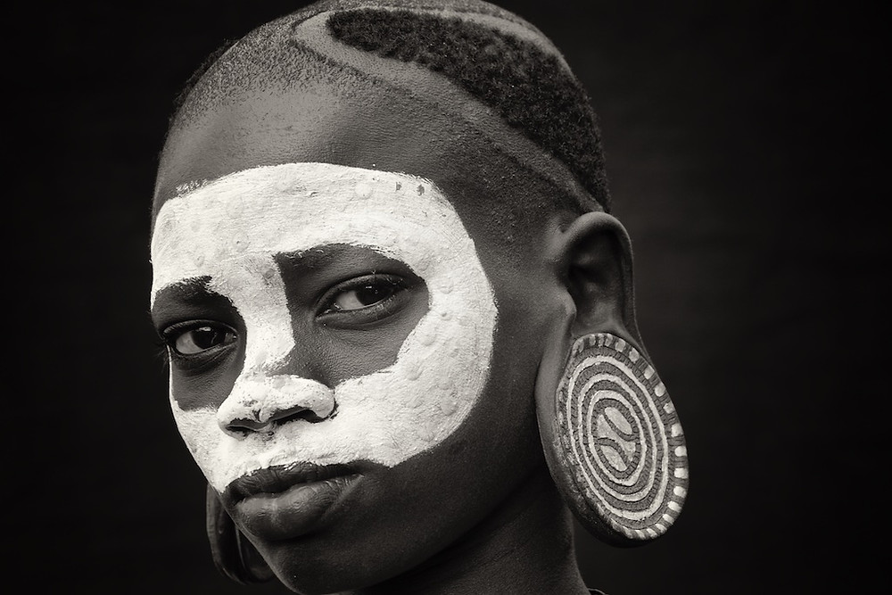 Surma girl with tribal makeup and earring