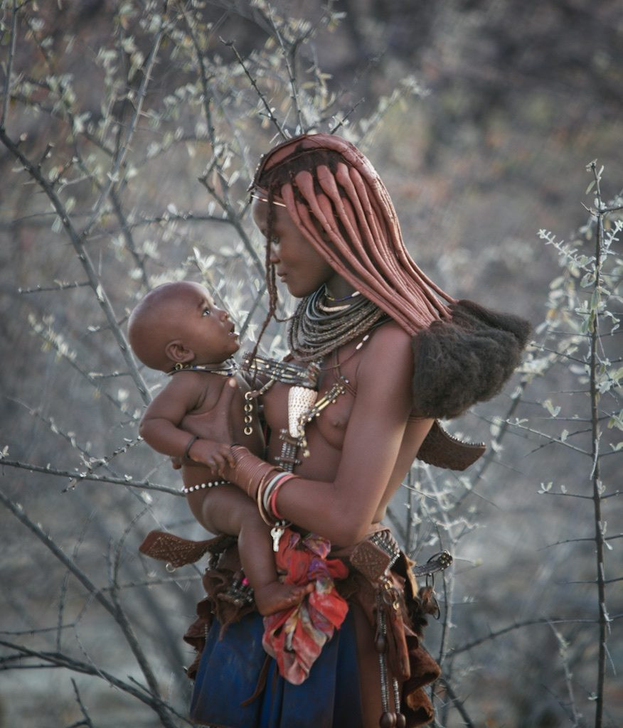 Himba mother holding her child