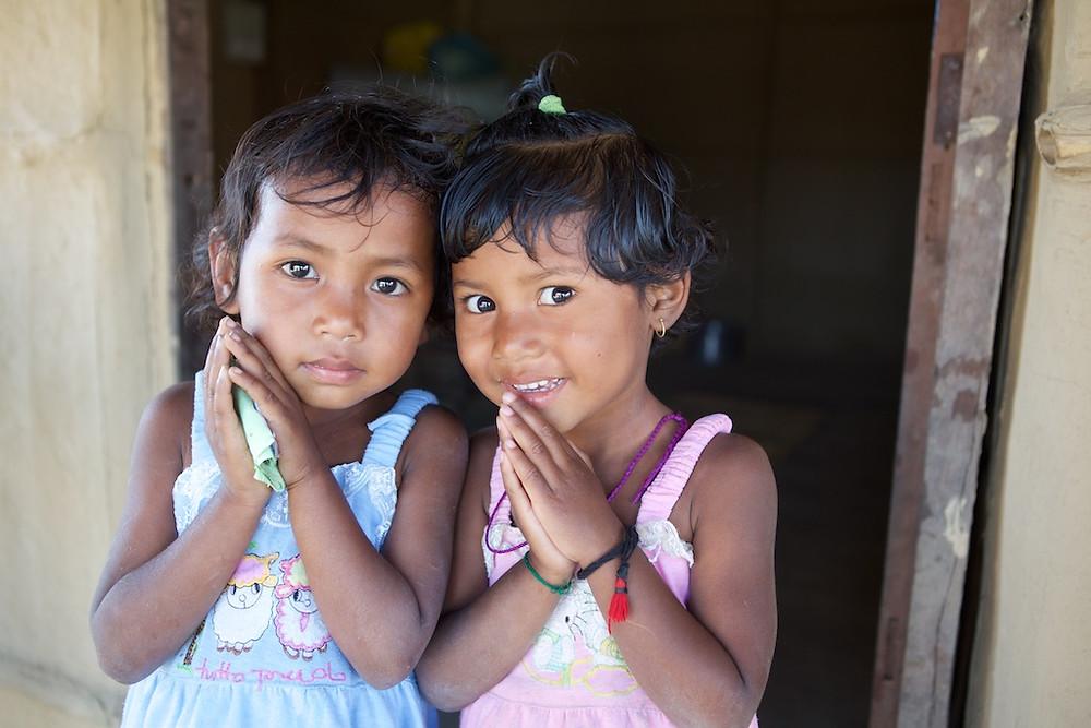 Nepali girls making namaste mudra