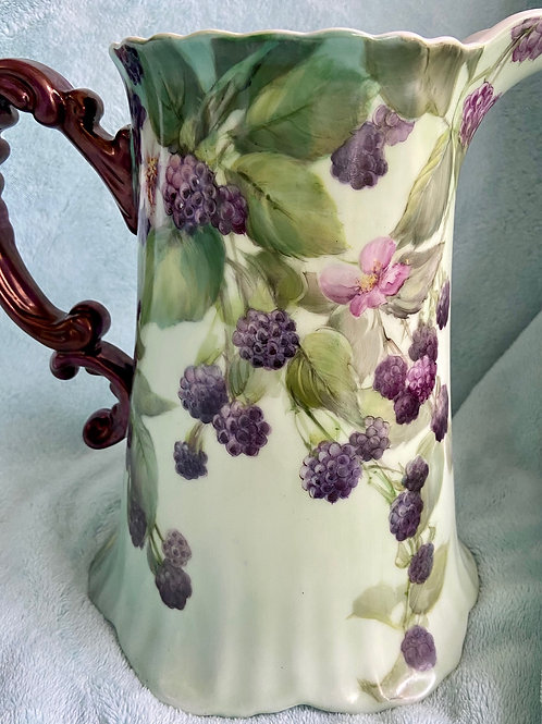 Berries on a Large Pitcher with a Soft Green Background