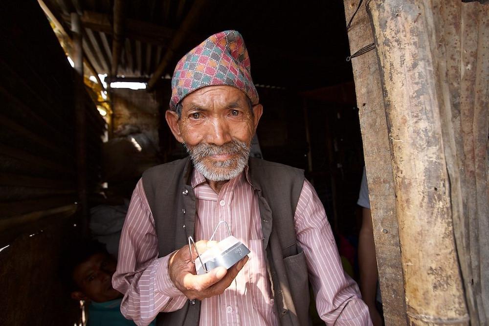 Older gentleman holding solar light