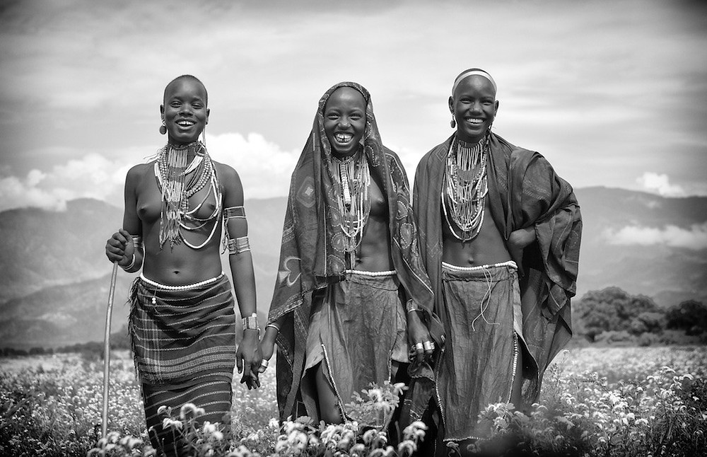 three Omo River Valley women in tribal dress