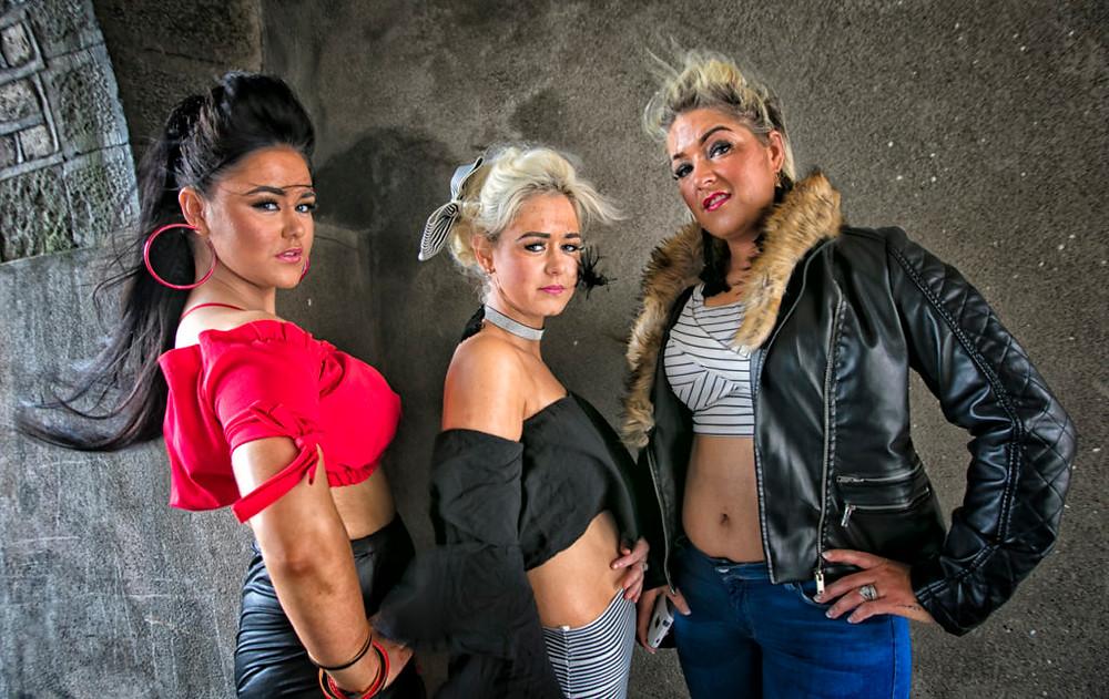 Three women pose