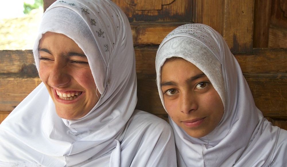 Two women in white coverings
