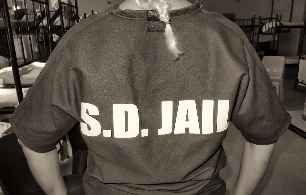 Shirt reads S.D. Jail