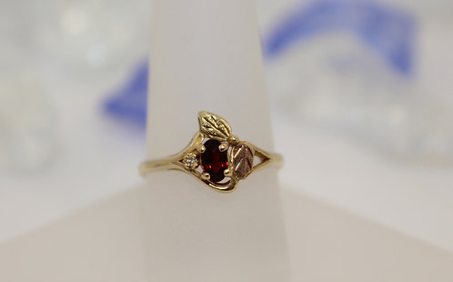 10 KT Black Hills Gold Garnet Ring with Diamond Accent