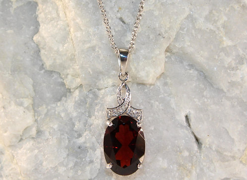 Sterling Silver Garnet Pendant with Diamond Accents