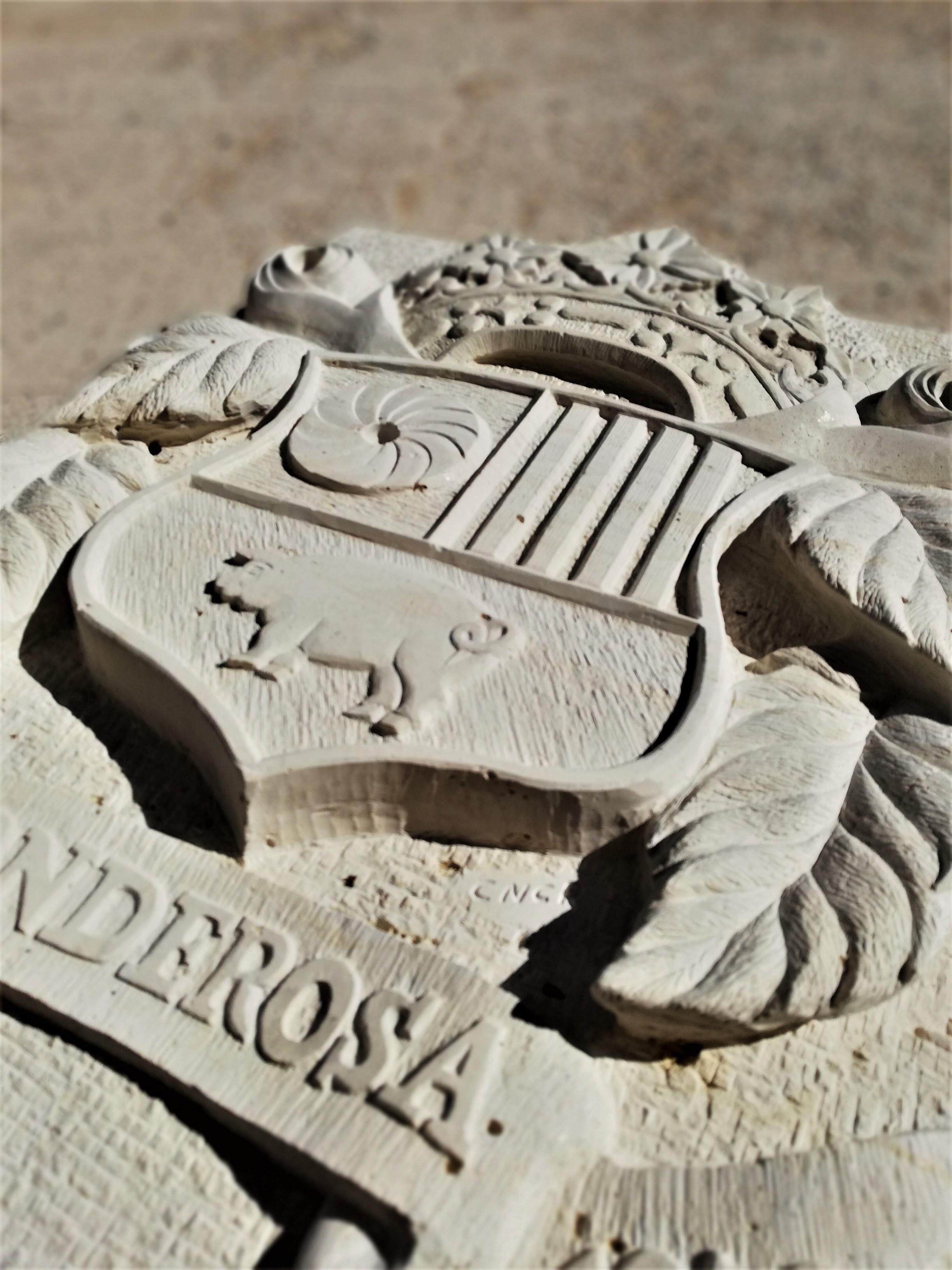 Escudo-la ponderosa-molinos-piedra-artes