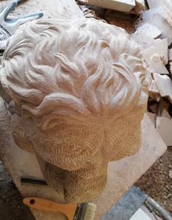 Detalle león-piedra-artesanía-talla-aren