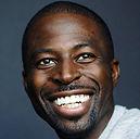 Headshot of Mohamed Massaquoi smiling