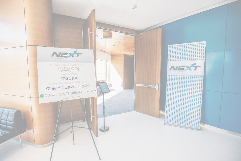 image of NEXT branded signage outside the open doors to the conference center