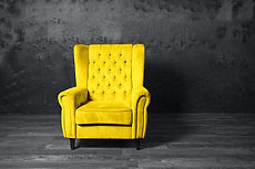 Yellow armchair over grey background. Tr