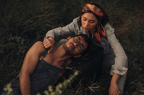 couple-relaxing-on-grassland-3441119 (1)