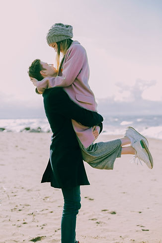 man-in-gray-coat-carrying-woman-wearing-