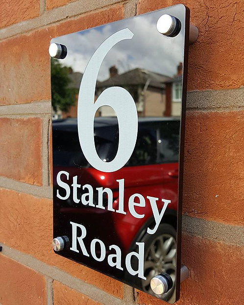Laser cut and engraved perspex house sign