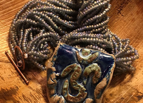 African Glass Bead Necklace with Handmade Clay Om Pendant