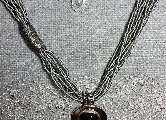 African Glass Bead Necklace with Oval Metal Pendant