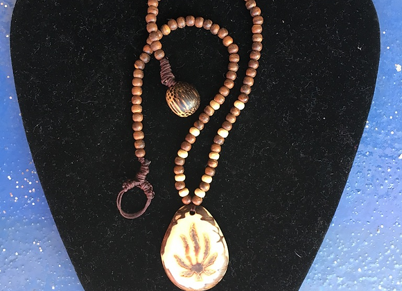 Wooden Bead Necklace with Carved Seed Pendant
