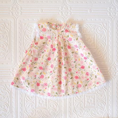 Faldón bebé Teresa Rifle flores rosa