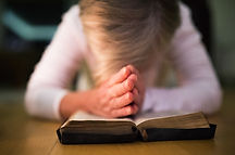 graphicstock-unrecognizable-woman-prayin