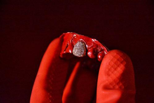 Pavè set diamond teeth