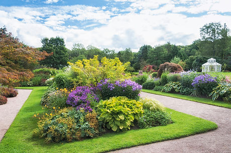 Botanical Garden, using hosts, annuals, evergreens, bushes, flowers, perennials, grasses, bamboos, flowers and trees.  Manicured lawns, grassed area, tured and pathways.  Contract offered for communal gardens, grounds, small estate management, business premises and school and local authority properties.