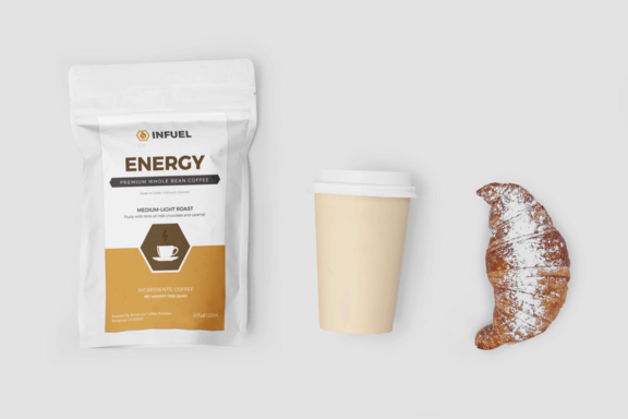 Infuel energy coffee beans, Take away coffee cup and croissant