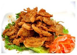 Lucky Lemongrass: Veggie fillet, lemongrass, lettuce, cucumber, tomatoes, carrots with homemade dressing served with steamed white rice or brown rice with sesame seed. $9.50