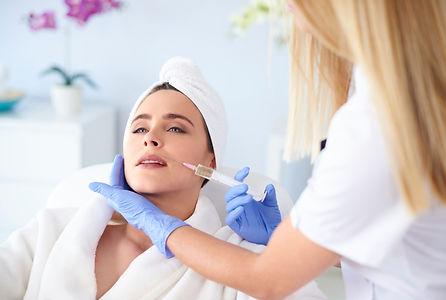 storyblocks-woman-at-salon-of-medical-ae