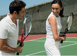 Tennis Coach & Client Practicing