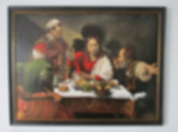 Framed copy of Caravaggio's Supper at Em
