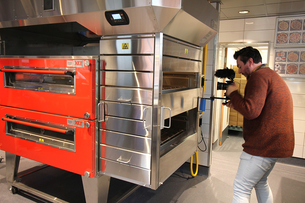 Oven being cleaned