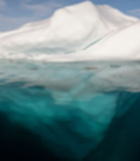 Iceberg_in_the_Arctic_with_its_underside_exposed.jpg