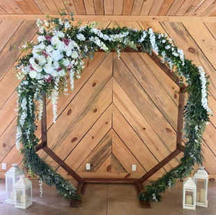 Chapel arbor option. Greenery/florals available to use.