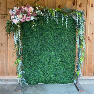 Available for photo backdrop. Greenery/florals available to use.