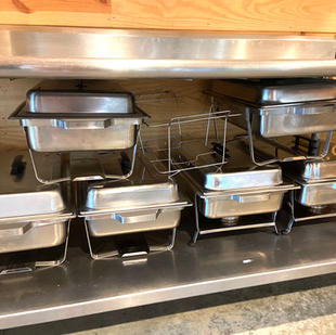 Chafer dishes for keeping food warm.