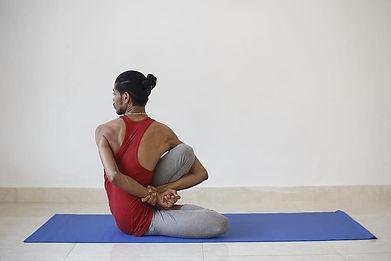 man-performing-yoga-on-mat.jpg
