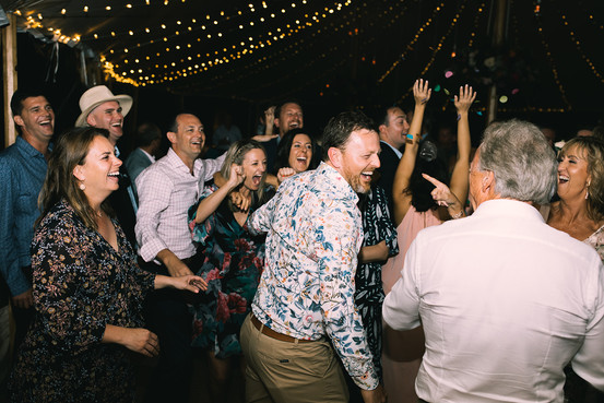 Guests dance at wedding reception in Byron Bay