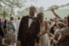 Bride and Groom exit ceremony while guests throw confetti at Montville wedding