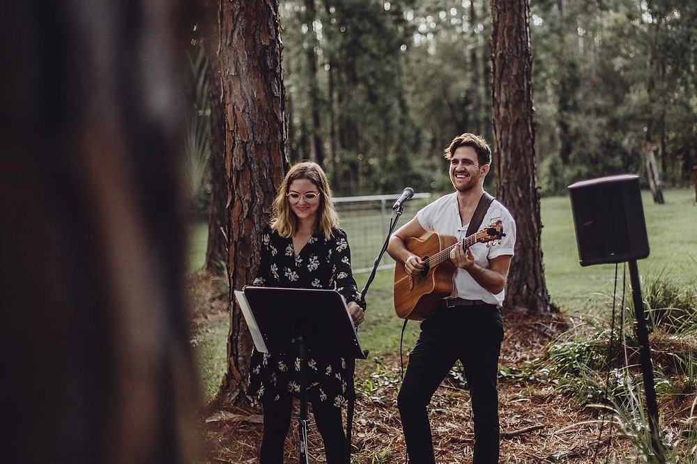The Famo's Duo playing a gorgeous outdoor ceremony for a wedding in Cooroibah, QLD