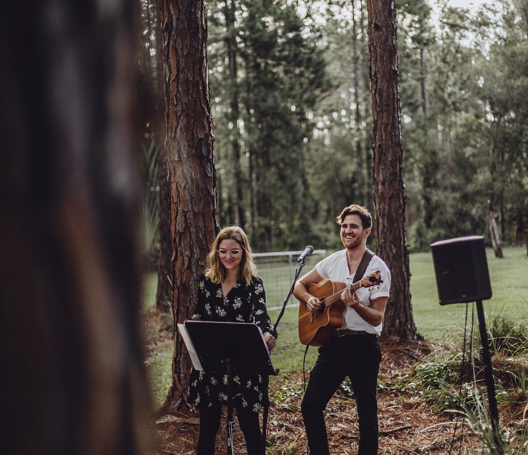"""Wedding singers """"The Famo's"""" perform at a wedding ceremony on the Sunshine Coast in the woods."""