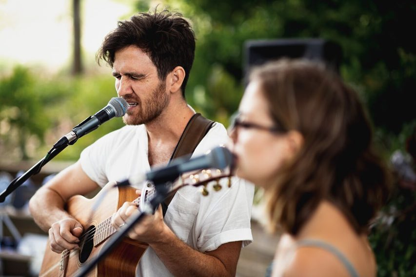 The Famo's Duo performing at a Maleny Hinterland wedding during canapés.