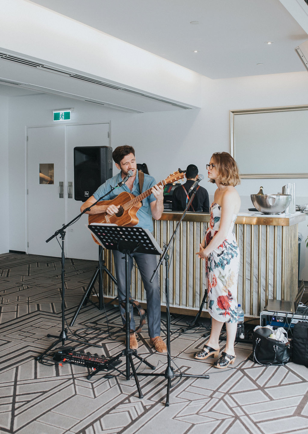 """Husband and Wife musical duo """"The Famo's"""" performing at a wedding ceremony in Brisbane."""