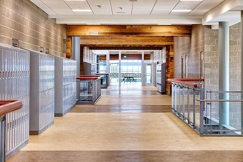 Empty and bright high school corridor with sunny windows