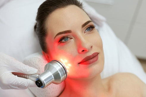 Facial Beauty Treatment. Woman Doing Red