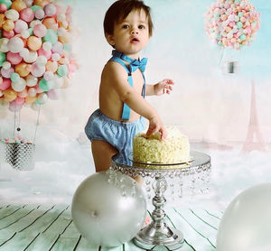 The Entire Cake Smash Cost Us GBP60 GBP15Background GBP8 Photo Stand GBP25 Balloons GBP5 Outfit GBP10