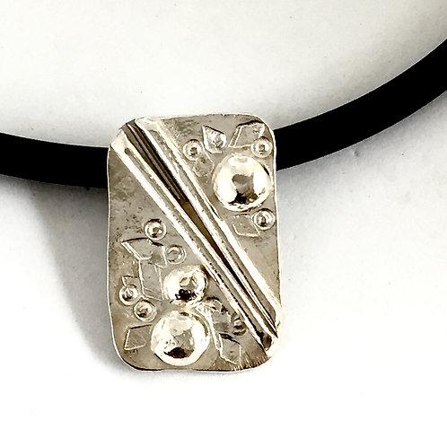 """Blowing Bubbles"" silver pendant on rubber"